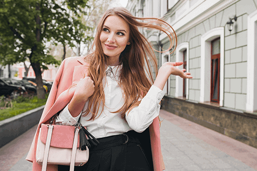 cute-attractive-stylish-smiling-woman-walking-city-street-pink-coat-spring-fashion-trend-holding-purse-elegant-style